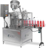 Bottles And Jugs Filling And Capping Rotary Machine -- PFM - Image